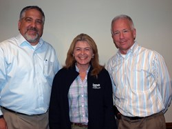 Kim Kavaliauskas (center) is shown with Mike Albert, KANE Sr. VP of Transportation (left), and Pete Westermann, President and CEO.