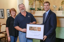Millionth patron, Tracy Heinold of Leominster, MA seen here with his wife Nancy and The Hanover Theatre's President & CEO, Troy Siebels in the Franklin Square Salon.