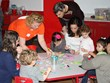 Children and parents participated in a fun arts & crafts project at Kidville Mount Kisco's Grand Opening celebration.