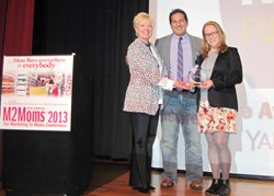 Nan McCann, Producer of M2Moms® and David Iudicia of Yahoo! present the Full Circle Award to Jill Risucci of The Hain Celestial Group at the 9th Annual M2Moms® Conference on October 24, 2013, Chicago.