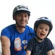 Glen Dobson, designer of Mac Ride bike seat for kids, with son Macinley