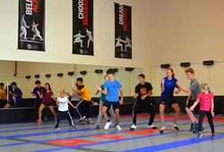 Fencers work on footwork drills during training at Academy of Fencing Masters