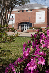 Admission building and azaleas in bloom