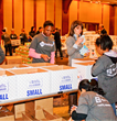 Volunteers fill Manhattan Mini Storage boxes with Thanksgiving dinners for the needy at the annual FeedingNYC event.