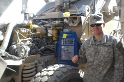 United States Staff Sgt. Daniel Wieman and the Leak Tamer smoke machine donated by OTC and Champion Engineering.