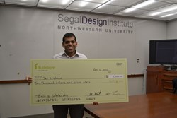 Jai Krishnan holding his check.