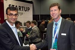 Arun Chhabra accepts congratulations on behalf of 2013 SPIE Startup Challenge winner 8tree from Jenoptik's Jay Kumler.