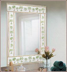Mirror decorated with a stained glass palm tree border.