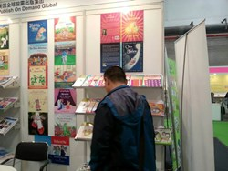 Participants browsing PODG's books at the Shanghai Children's Copyright Book Fair 2013
