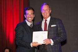 D Custom president Gordon Price Locke accepts an award at the 2013 Pearls ceremony.