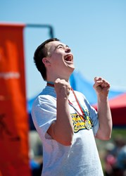 Special Olympics AZ athlete Grant Miller celebrates after receiving his medal.
