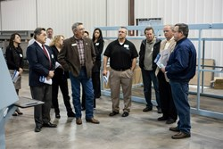 DMS CEO, Patrick Bollar gives a manufacturing floor tour to a group including County Commissioner, Dennis Hisey and James Irwin Charter Schools CEO, Jonathan Berg