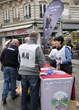 """Volunteers from Scientology Churches of Paris share the message that life is """"much cooler"""" when it is moral, at The Way to Happiness booth November 2, 2013, in the Paris suburb of St. Denis."""