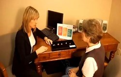 Award-Winning Charleston Audiologist Dr. Mary Anne Larkin with Patient