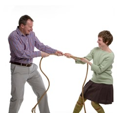 A man and a woman in a tug of war