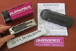 Pulmonica and box, cloth, carrying case, instructions, sticker