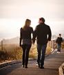 Couple walking along Moonstone Beach