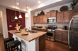 The Promenade Ranch Model offers a roomy kitchen with island.