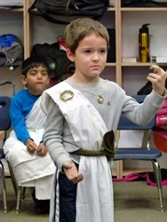 """One of Primoris Academy's students showing off Roman attire during the """"Rome Day"""" fashion show."""