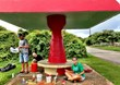 Greg Reynolds, Rich Stump and Chris Broders paint a bus stop in Guam.