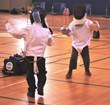 Students in kindergarten through 8th grade participate in fencing at Everest Academy in Lemont, IL.