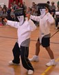 Everest Academy students demonstrate their fencing technique as they warm up for the academy's first fencing competition.