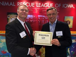 Fred Eastman of Iowa Rural Health Association congratulates Dr. William Appelgate of Iowa Chronic Care Consortium