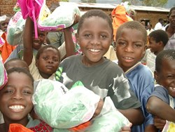 Kids in Malawi with mosquito nets