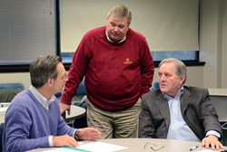 photo: business leaders discuss plans for aquaponics.