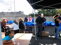 Staff members at Bisnar Chase Personal Injury Attorneys give out free turkeys