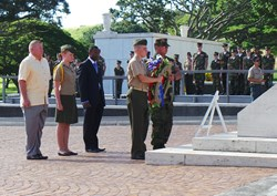 Young Marines perform a wreath laying ceremony at Pearl Harbor