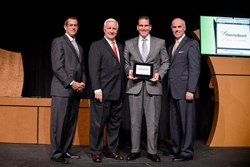 John Landry, our Director, Account Management, Eastern Region, accepting the award along with (left to right) David Capitano from ParenteBeard LLC, Governor Tom Corbett and John Moran from Team Pennsylvania Foundation.