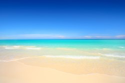 A photograph of Grace Bay Beach, Turks and Caicos Islands