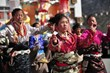 Tibetans dance to celebrate Tibetan New Year.