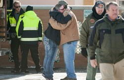 6 RESCUED: A woman hugs Chris Montes after hearing that Montes was one of the rescuers that found a family in a remote mountain range northeast of Reno, in Lovelock, Nevada, Dec. 10. Photo: Reuters/James Glover - See more at: http://kmit.com/news/030030-6