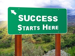 "a signpost showing the direction of ""success"""