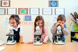 "Five year-old students using microscopes doing forensic microbiology as part of Primoris Academy's ""S.B.I."" (Scientific Bureau of Investigation) class."