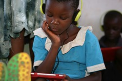 Little girl from Malawi learning maths with EuroTalk's Masamu apps