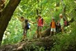 family hiking downhill in lush area