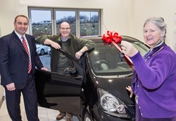 Sandy Mackenzie, General Manager, Macrae & Dick Toyota hand over the keys to a brand new Toyota AYGO to Mr and Mrs Campbell