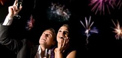 couple with champagne watching fireworks