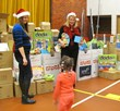 SME's Meghan Shea-Keenan (l) and Debbie Holton (r),give STEM toys to children at Toys for Tots in River Rouge, Mich.