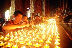 Thousands of butter lamps lighten at the night of Butter Lamp Festival.