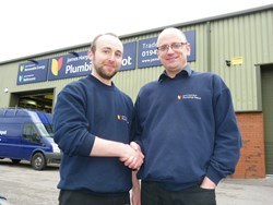 New recruit Chris Schofield (left) and James Hargreaves Plumbing Depot Wigan branch manager Mick Fee.