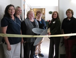 Executive Director Amber McIntosh cutting the ribbon for Morrison Place at Abernethy Laurels