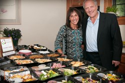 Apollo Grill Restaurant co-owner Dyanne Holt with Bob Agentis, founder of Judith Adele Agentis Charitable Foundation, and Judie's Table. 