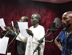 Actors read the scripts for a new radio soap opera in Nigeria.
