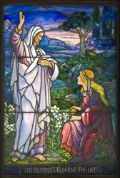 Gorgeous Tiffany Studios leaded stained glass window, 5 feet 3 inches tall, signed L. C. Tiffany (est. $60,000-$80,000).