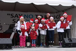 Two generations of Drug-Free Marshals sang Christmas Carols at the annual Drug-Free Marshals Christmas Festival at Yonge-Dundas Square in Toronto in December 2013.