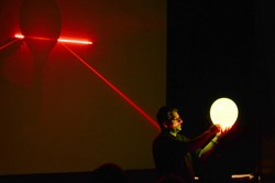 Red plus green makes ... yellow, when it comes to lasers, demonstrates Laser Roadshow founder Chris Volpe during an middle school presentation earlier this year.